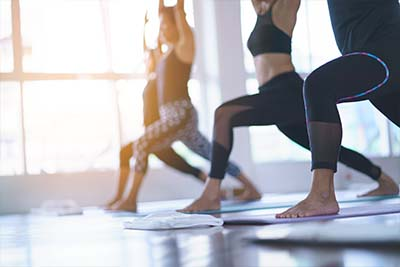group participates in yoga therapy